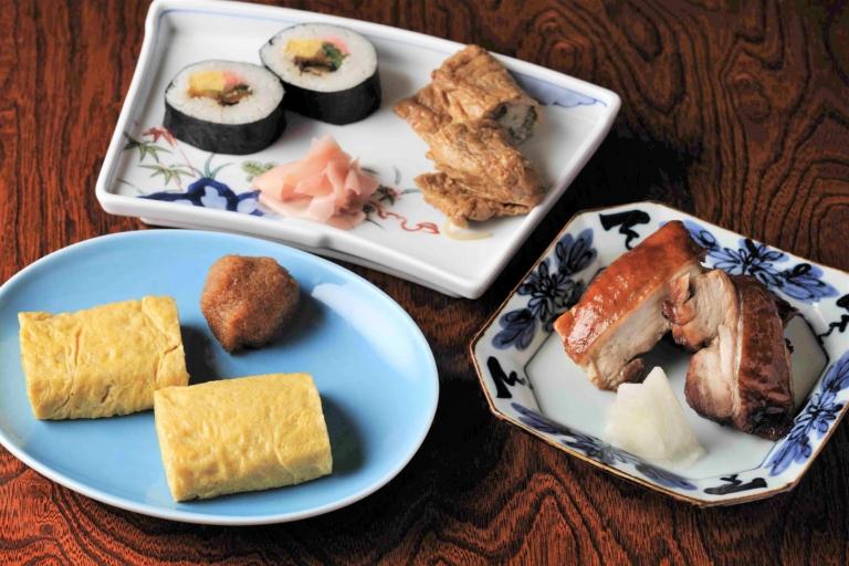 En quoi consiste ce « tronc » de la culture traditionnelle qui doit être perpétuée que l'on retrouve dans le rakugo et la cuisine japonaise ?